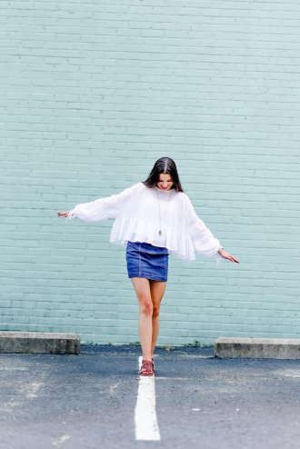 senior photography, portrait photography, blue wall, summr outfit, hippie outfit, denim skirt, flowy shirt, minimalist photography, bold colors, blue colors, pop colos, fun portraits